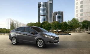 Photo - This undated product image provided Ford shows the 2014 Ford Fiesta sedan. The 2014 Fiesta four door with SE EcoBoost package has government fuel economy ratings as high as those for some diesel-powered sedans from BMW, Audi and Volkswagen. (AP Photo/Ford)