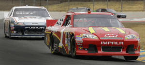 Photo -   Driver Jamie McMurray (1) leads Josh Wise during practice for Sunday's NASCAR Sprint Cup Series auto race Friday, June 22, 2012, in Sonoma, Calif. (AP Photo/Ben Margot)