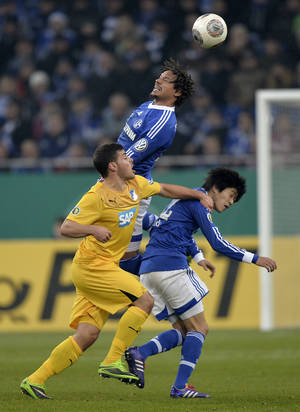 Photo - Hoffenheim's Kevin Volland, Schalke's Jermaine Jones, top, and Schalke's Atsuto Uchida, right, challenge for the ball during the German soccer cup third round match between FC Schalke 04 and TSG Hoffenheim in Gelsenkirchen, Germany, Tuesday, Dec. 3, 2013. (AP Photo/Martin Meissner)