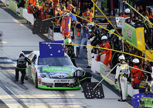 Photo -   Kyle Busch pits during a NASCAR Sprint Cup Series auto race, Sunday, Sept. 30, 2012, at Dover International Speedway in Dover, Del. (AP Photo/Nick Wass)