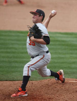 Photo - Oklahoma State relief pitcher Vince Wheeland (35) throws from the mound against Baylor in the third inning of an NCAA college baseball game on Saturday, March 22, 2014, in Waco, Texas. (AP Photo/Waco Tribune Herald, Rod Aydelotte)