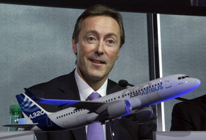 photo - Airbus CEO Fabrice Bregier, speaks during the annual press conference for commercial results in Toulouse, southwestern France, Thursday, Jan. 17, 2013. Airbus says it delivered a record 588 aircraft last year, while taking in gross order for 914 new jets, is well above its earlier forecasts. A model of an Airbus 320 in the foreground. (AP Photo/Michel Euler)