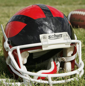 Photo - BLACK WATCH HELMET: Football helmet worn by selected players at Lawton High School.  Photographed Wednesday, Oct. 17, 2007.   By Jim Beckel,  The Oklahoman.  ORG XMIT: KOD