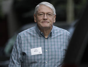 photo - FILE - In this Wednesday, July 11, 2012, file photo, John Malone. chairman of Liberty Media and CEO of Discovery Holding Company. arrives at the Allen & Company Sun Valley Conference in Sun Valley, Idaho. Liberty Global Inc., the cable TV operator controlled by Malone, announced Wednesday, Feb. 6, 2013, it s buying U.K.-based Virgin Media Inc. in a $16 billion deal that steps up the rivalry between Malone and fellow billionaire Rupert Murdoch. (AP Photo/Paul Sakuma, File)