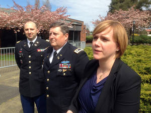 Photo - Capt. Matt Aiesi, Maj. Greg Malson and civilian Emma Scanlan, attorneys for Staff Sgt. Robert Bales, speak with reporters at Joint Base Lewis-McChord, Wash., Tuesday, April 23, 2013, following a hearing in his case. Bales could face the death penalty if convicted of massacring 16 Afghan villagers in Kandahar Province last March. (AP Photo/Gene Johnson)