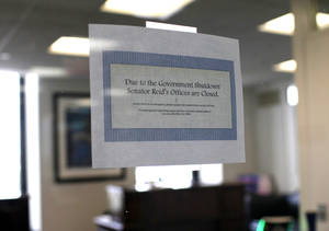 Photo - A sign hangs on the window of Senate Majority Leader Harry Reid's office on Capitol Hill in Washington, Thursday, Oct. 3, 2013.   (AP Photo/Molly Riley)