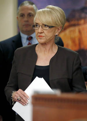 Photo - Arizona Republican Gov. Jan Brewer arrives before speaking at a news conference announcing she has vetoed SB1062, a bill designed to give added protection from lawsuits to people who assert their religious beliefs in refusing service to gays, at the Arizona Capitol on Wednesday, Feb. 26, 2014, in Phoenix. (AP Photo/Ross D. Franklin)