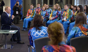 "Photo - Russian President Vladimir Putin, left,  speaks at his meeting with Olympic volunteers in the Black Sea resort of Sochi, Russia, Friday, Jan. 17, 2014. Putin says gays should feel welcome at the upcoming Winter Olympic Games in Sochi, but they must ""leave the children in peace."" Putin told volunteers Friday that gays visiting Sochi ""can feel calm and at ease,"" and vowed that there would be no discrimination at the games. But he emphasized that, according to a law banning homosexual ""propaganda"" among minors, gays cannot express their views on gay rights issues to anyone underage. (AP Photo/RIA-Novosti, Alexei Nikolsky, Presidential Press Service)"