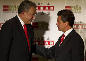 Photo -   FILE - In this June 14, 2012 file photo, then presidential candidate Enrique Pena Nieto, right, of the Institutional Revolutionary Party, greets retired Colombian Gen. Oscar Naranjo during a press conference in Mexico City. Naranjo, who was named top security advisor by President-elect Pena Nieto, said Friday, July 6, 2012, that he is recommending the creation of elite units of police and troops who will target not just major drug traffickers but also lower-level cartel hitmen as a way of swiftly reducing violence. (AP Photo/Christian Palma, File)