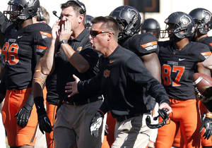 Photo - Oklahoma State head coach Mike Gundy argues a call at the end of the first half during of a college football game between the Oklahoma State University Cowboys (OSU) and the Kansas State University Wildcats (KSU) at Boone Pickens Stadium in Stillwater, Okla., Saturday, Oct. 5, 2013. OSU won 33-29.Photo by Sarah Phipps, The Oklahoman