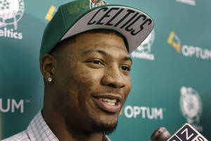Photo - Boston Celtics 2014 NBA basketball draft pick Marcus Smart speaks with members of the media Monday, June 30, 2014, in Waltham, Mass. (AP Photo/Steven Senne)