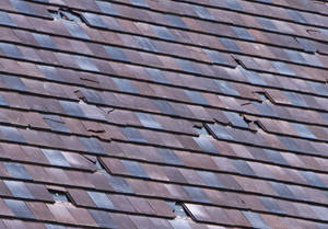 photo - Broken slate roofing is seen at Christ the King Catholic Church from Tuesday night's hailstorms. Photo by David McDaniel, The Oklahoman
