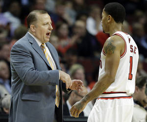 Photo - Chicago Bulls head coach Tom Thibodeau, left, talks with guard Derrick Rose during the first half of an NBA preseason basketball game against the Detroit Pistons in Chicago on Wednesday, Oct. 16, 2013. (AP Photo/Nam Y. Huh)