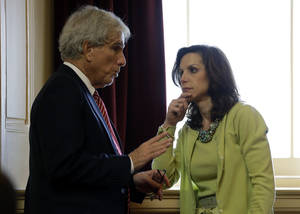 Photo - State Sen. Richard Saslaw, D-Fairfax, left, talks with Sen. Jill Vogel, R-Fauquier, during debate on the transportation funding bill at the Capitol in Richmond, Va., Saturday, Feb. 23, 2013.  The Senate passed the measure.   (AP Photo/Steve Helber)