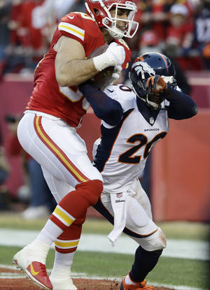 Photo - Kansas City Chiefs tight end Anthony Fasano (80) makes a touch-down reception against Denver Broncos strong safety Mike Adams (20) during the first half of an NFL football game, Sunday, Dec. 1, 2013, in Kansas City, Mo. (AP Photo/Charlie Riedel)