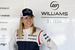 Photo - FILE - In this Jan. 30, 2012, photo taken from files and released by the Williams F1 Team on Wednesday, May 8, 2013, Susie Wolff poses for a photo at the Monte Blanco Circuit in Spain. Susie Wolff will become the first woman in 22 years to compete in a Formula One event during the upcoming season as she chases a chance to race for Williams. The 31-year-old Scot will take part in the first practice session ahead of both the British and German Grands Prix as part of her expanded development driver role with Williams. Wolff will take to the track at Silverstone ahead of the British GP in July, having made her full F1 test debut at the circuit last July. (AP Photo/Williams F1 Team, Malcolm Griffiths, File)