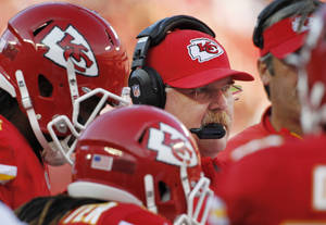 Photo - Kansas City Chiefs coach Andy Reid stands with his players during the first half of an NFL football game against the Houston Texans at Arrowhead Stadium in Kansas City, Mo., Sunday, Oct. 20, 2013. (AP Photo/Colin E. Braley)