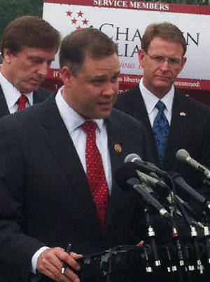 Photo - Rep. Jim Bridenstine, R-Tulsa, speaks Tuesday at a Capitol Hill news conference on religious freedom in the U.S. military. <strong>Chris Casteel - The Oklahoman</strong>