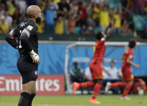 Photo - United States' goalkeeper Tim Howard reacts after Belgium's Romelu Lukaku scored his side's second goal during the World Cup round of 16 soccer match between Belgium and the USA at the Arena Fonte Nova in Salvador, Brazil, Tuesday, July 1, 2014.   (AP Photo/Julio Cortez)