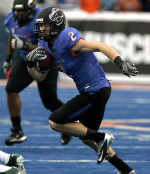 Photo -   Boise State's Thomas Coffman (2) runs for a first down against Colorado State during the first half of an NCAA college football game on Saturday, Nov. 17, 2012 in Boise, Idaho. (AP Photo/Matt Cilley)
