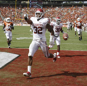 Photo - Oklahoma's Jamell Fleming (32) returns an interception for a touchdown during the Red River Rivalry college football game between the University of Oklahoma Sooners (OU) and the University of Texas Longhorns (UT) at the Cotton Bowl in Dallas, Saturday, Oct. 8, 2011. Photo by Bryan Terry, The Oklahoman