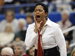 Photo - Central Florida coach Joi Williams calls out to her team during the first half of an NCAA college basketball game against Connecticut, Wednesday, Feb. 19, 2014, in Hartford, Conn. (AP Photo/Jessica Hill)