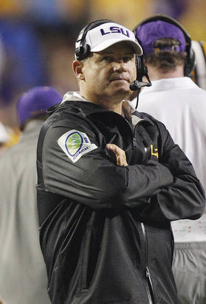 photo -   LSU coach Les Miles stands on the sidelines during the second half against Towson in an NCAA college football game in Baton Rouge, La., Saturday, Sept. 29, 2012. (AP Photo/Bill Haber)