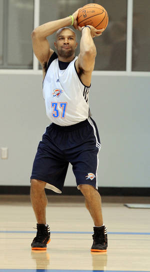 Photo - Derek Fisher shoots after practice at the Oklahoma City Thunder practice facility on Friday, April 27, 2012, in Oklahoma City, Okla.  Photo by Steve Sisney, The Oklahoman