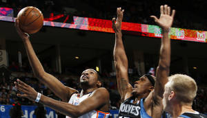 photo - Oklahoma City's Kevin Durant (35) lays up a shot past Minnesota's Dante Cunningham (33) and Greg Stiemsma (34) during an NBA basketball game between the Oklahoma City Thunder and Minnesota Timberwolves at Chesapeake Energy Arena in Oklahoma City, Friday, Feb. 22, 2013. Photo by Nate Billings, The Oklahoman