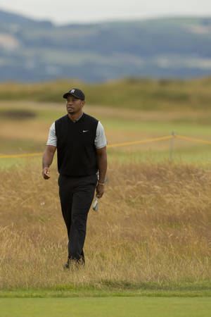 Photo - Tiger Woods of the US walks towards the 16th green during a practice round at Royal Liverpool Golf Club prior to the start of the British Open Golf Championship, in Hoylake, England, Saturday, July 12, 2014. The 2014 Open Championship starts on Thursday, July 17. (AP Photo/Jon Super)