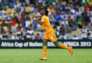 photo - Ivory Coast's Didier Drogba enters the pitch in the second half of their African Cup of Nations group D match against Tunisia at the Royal Bafokeng stadium in Rustenburg, South Africa, Saturday, Jan. 26, 2013. The two other teams in group D are Togo and Algeria. (AP Photo/Armando Franca)