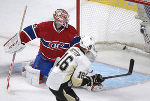 Photo - Montreal Canadiens goaltender Carey Price, left, is scored on by Pittsburgh Penguins' Brandon Sutter during overtime in an NHL hockey game Saturday, March 2, 2013, in Montreal. Pittsburgh won 7-6. (AP Photo/The Canadian Press, Graham Hughes)