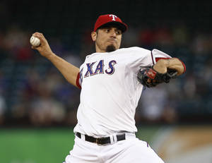 Photo - FILE - In this Sept. 26, 2013 file photo, Texas Rangers starting pitcher Matt Garza delivers a pitch to the Los Angeles Angels during the first inning of a baseball game in Arlington, Texas. Garza signed a four-year contact with the Milwaukee Brewers on Sunday, Jan. 26, 2014. (AP Photo/Jim Cowsert, File)