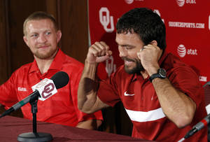 photo - OU: Jared Frayer (right) gestures during a press conference on Thursday, July 5, 2012 in Norman, Okla. He and fellow wrestler Sam Hazewinkel (left) are among six athletes from the University of Oklahoma who have qualified for the 2012 London Olympics in track and field, wrestling and men's gymnastics. Photo by Steve Sisney, The Oklahoman