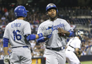 Photo - Los Angeles Dodgers' Hanley Ramirez is congratulated by Dodgers' Andre Ethier after scoring against the San Diego Padres in the first inning of an MLB National League baseball game Wednesday, April 2, 2014, in San Diego.  (AP Photo/Lenny Ignelzi)