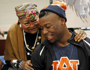 photo - Khari Harding talks to his grandmother, Mary Harding, after the signing day ceremony at Edmond Santa Fe High School in Edmond, Okla., Wednesday, Feb. 6, 2013. Harding will play football at Auburn. Photo by Nate Billings, The Oklahoman