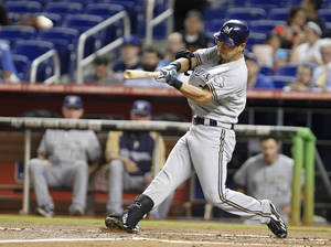 photo -   Milwaukee Brewers' Norichika Aoki, of Japan, hits a two-run home run scoring Shaun Marcum during the second inning of a baseball game against the Miami Marlins, Tuesday, Sept. 4, 2012, in Miami. (AP Photo/Wilfredo Lee)