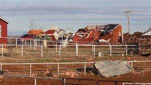 Photo - In this Tuesday, March 9, 2010 photo provided by John W. Cannon of the Elk City Daily News, damage is shown after a Tornado struck Hammon, Okla. on Monday. (AP Photo/Elk City Daily News, John W. Cannon)