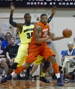 Photo - Baylor forward Cory Jefferson (34) guards Syracuse forward DaJuan Coleman (32) in the first half of an NCAA college basketball game at the Maui Invitational on Wednesday, Nov. 27, 2013, in Lahaina, Hawaii. (AP Photo/Eugene Tanner)