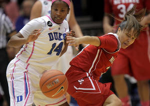 Photo - Duke's Ka'lia Johnson (14) battles for a loose ball with NC State's Miah Spencer, right, during the first half of an NCAA college basketball game in Durham, N.C., Thursday, Feb. 20, 2014.  (AP Photo/Ted Richardson)