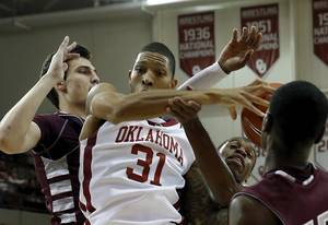Photo - Oklahoma Sooner D.J. Bennett (31) is fouled on a shot as the University of Oklahoma Sooner (OU) men play the Oklahoma Christian Eagles in an exhibition, college basketball game at McCasland Field House on Monday, Nov. 4, 2013  in Norman, Okla. Photo by Steve Sisney, The Oklahoman