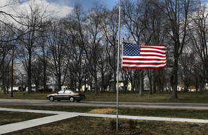 photo - CORRECTS DAY OF EXPLOSION TO MONDAY INSTEAD OF TUESDAY - Marine Aaron Ripperda of Highland, Ill. is remembered with flags at half mast in nearby downtown Marine, Ill., where his father lives, Wednesday, March 20, 2013. Ripperda was killed with six other Marines in an explosion during a Nevada training exercise on Monday. (AP Photo/St. Louis Post-Dispatch, Robert Cohen)  EDWARDSVILLE INTELLIGENCER OUT; THE ALTON TELEGRAPH OUT