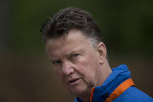 Photo - FILE - In this Thursday, May 15, 2014 file photo, Louis Can Gaal, coach of the Dutch national soccer team walks towards the mixed zone after a team training in Hoenderloo, eastern Netherlands. Manchester United has hired Netherlands coach Louis Van Gaal as the club's new manager it was announced on Monday, May 19, 2014. Van Gaal, who will leave his position with the Dutch after the upcoming World Cup in Brazil, replaces David Moyes following his firing last month after just 10 months in charge.  (AP Photo/Peter Dejong, File)