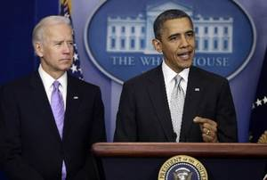 photo - President Barack Obama stands with Vice President Joe Biden as he makes a statement Wednesday, Dec. 19, 2012, in the Brady Press Briefing Room at the White House in Washington, about policies he will pursue following the massacre at Sandy Hook Elementary School in Newtown, Ct. Obama is tasking Biden, a longtime gun control advocate, with spearheading the effort. (AP Photo/Charles Dharapak) 