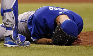 Photo - Toronto Blue Jays starting pitcher J.A. Happ reacts after being hit in the head by a line drive from Tampa Bay Rays' Desmond Jennings during the second inning of a baseball game Tuesday, May 7, 2013, in St. Petersburg, Fla. (AP Photo/Mike Carlson)