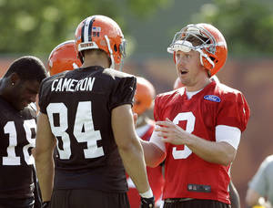 Photo - Cleveland Browns quarterback Brandon Weeden (3) talks to tight end Jordan Cameron (84) during training camp practice at the NFL football team's facility in Berea, Ohio, Friday, July 26, 2013. (AP Photo/Mark Duncan) <strong>Mark Duncan</strong>