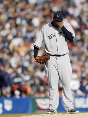 photo -   New York Yankees' CC Sabathia wipes his face after Detroit Tigers' Omar Infante scored in the first inning during Game 4 of the American League championship series Thursday, Oct. 18, 2012, in Detroit. (AP Photo/Paul Sancya )