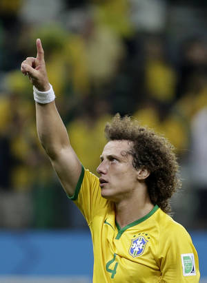 Photo - Brazil's David Luiz reacts after the group A World Cup soccer match between Brazil and Croatia, the opening game of the tournament, in the Itaquerao Stadium in Sao Paulo, Brazil, Thursday, June 12, 2014.  Brazil won the match 3-1. (AP Photo/Felipe Dana)