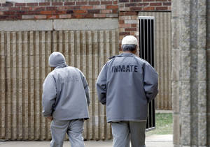 Photo - Inmates walks on the grounds of the Joseph Harp Correctional Center in Lexington, Okla., on Friday, January 4, 2008. BY SARAH PHIPPS, THE OKLAHOMAN
