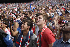Photo - Fans watch as Belgium scores against the U.S. during the Brazil 2014 World Cup viewing party at Solider Field on Tuesday, July 1, 2014 in Chicago. Belgium defeated the U.S. 2-1. (AP Photo/Stacy Thacker)